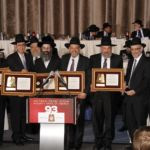 Avodas Hakodesh Awardees, Dr. Elliot Samet, Rabbi Menashe Miller,Rabbi Benzion Leser, Yerachmiel Bratt, and Naftali Besser, flanked by Rabbi Shlomo Gertzulin, Executive Vice President for Finance and Administration of Agudath Israel, Rabbi Chaim Dovid Zwiebel, Rabbi Yonah Feinstein, Director of Special Projects