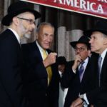 Rabbi Chaim Dovid Zwiebel, Senator Charles Schumer, Shlomo Werdiger, Chairman of the Board of Trustees of Agudath Israel of America, and Dr. David Diamond.