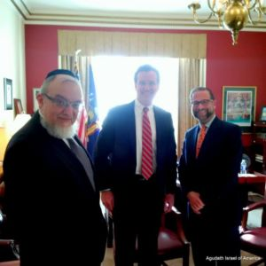 Rabbi Shmuel Lefkowitz, Agudath Israel's vice president for community affairs (L) and  Leon Goldenberg, member of the board of trustees (R) discussing the organization's 2016 legislative agenda with Senate Majority Leader John Flanagan in Albany