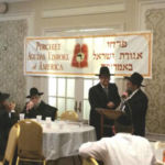 Rabbi Peretz Levin (sitting) Rabbi Schwartz, Rabbi Levi