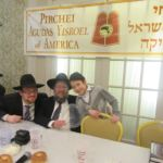 Rabbi Schwartz and Rabbi Levi with one of the Pirchim