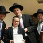 Prize winner with Shmuel Kagan, Mordechai Joseph and Rabbi Ephraim Levi.