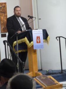 Rabbi Ephraim Eliyahu Shapiro addressing the Agudah Siyum Daf Yomi on Bava Metzia