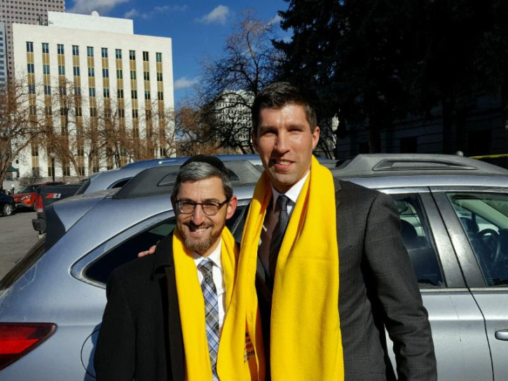 Rabbi Ahron Wasserman of Denver thanking the chairman of the Colorado Senate Education Committee Senator Owen Hill, for his strong support of school choice