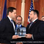 Chaskel Bennett presents Senator Rubio with Daring to Dream, Profiles in the Growth of the American Torah Community, published by Agudath Israel of America