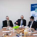 At head of table (L-R) Rabbi Labish Becker, Rabbi Yeruchim Silber, Rabbi Shia Markowitz