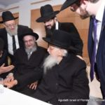Gathered around Rabbi Aharon Schechter...