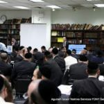 Rabbi Ami Bazov, Esq., Agudath Israel Education Affairs Coordinator, directing test-takers