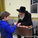 Chananya Minster from Cincinatti Giving Shalom to Rabbi Sholom Shapiro
